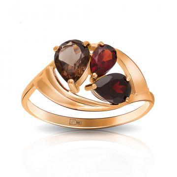 Кольцо из золота с гранатом и раух-топазами